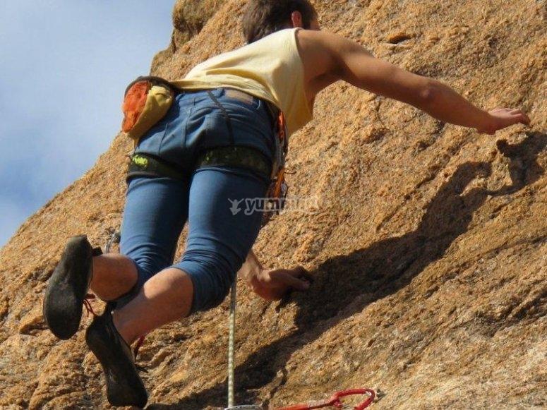 Climbing up the rock wall