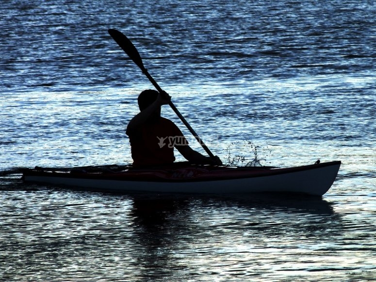 In the water with the canoe