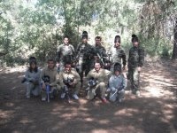 Friends playing paintball
