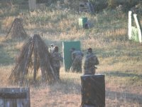 Playing paintball in natural scenery