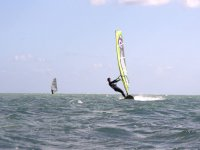 Practicing windsurfing with neoprene and helmet