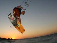 Sunset doing kitesurfing