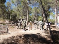 Paintball players in forest