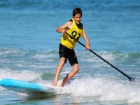 Child in paddle surf class