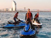 On the jet skis with Barna behind