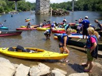 Removing kayaks from the shore