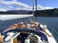 Lying sunbathing on deck