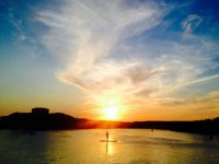 Sup crossing with sunset