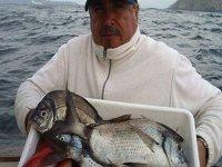 cliente con su pesca