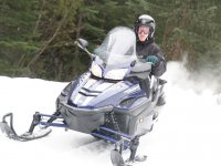 Carrying a snowmobile