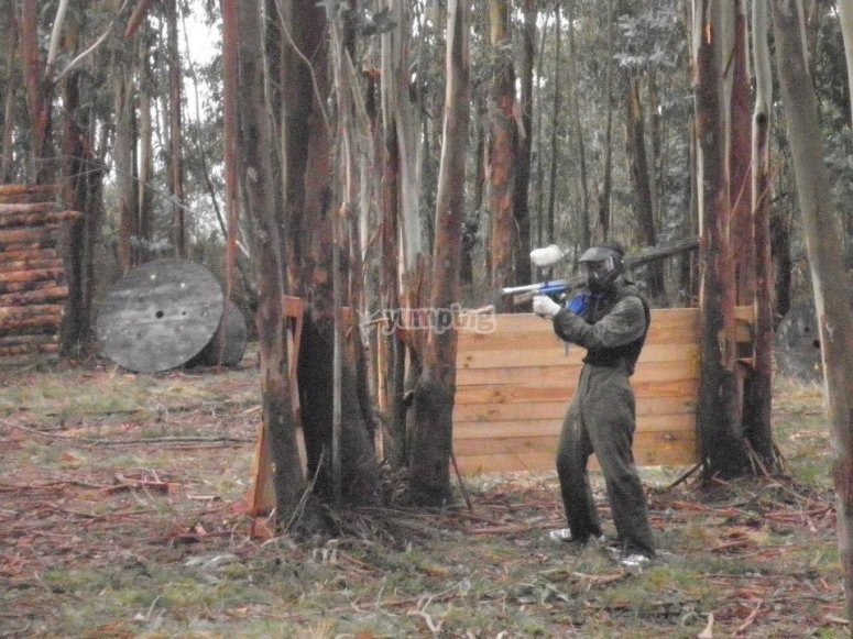 Playing paintball, in natural scenary