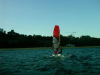 Practicing windsurfing in Santander