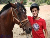 Alumno con caballo