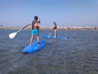 Students practicing sup in Malaga