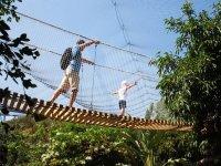 Crossing the suspension bridge in Estepona