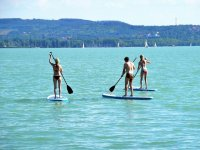 Group of three on the sup surfboards