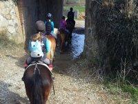 En caballo por el pasadizo