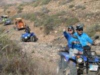 Quad y buggy en la ruta de montana