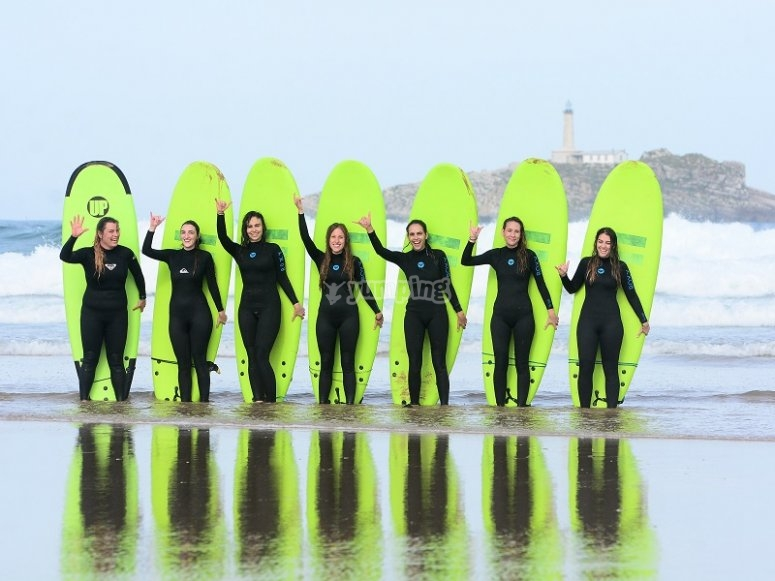 Uniformed with surfboards and neoprene
