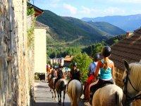 On horseback through the village