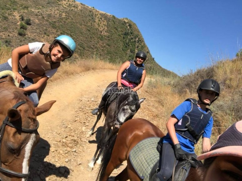Youngsters doing a horse riding tour