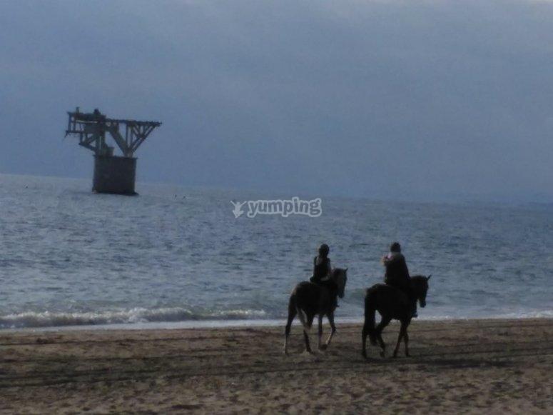 En la playa con los caballos