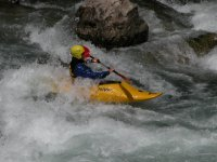 Passing the rapids with the canoe