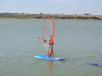 Child in windsurfing in Arcos