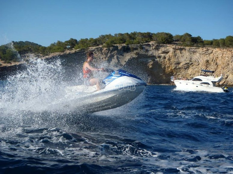 Guy jumping with the jet ski