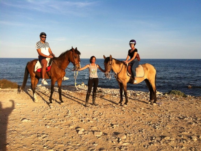With the horse riding instructor