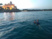 Swimming with the Tamarit castle in the background