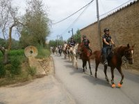 Passing with the horses through the village
