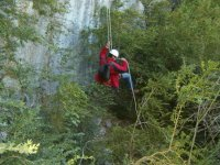 Rappelling in dry ravine