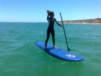 Standing up on the surfboard