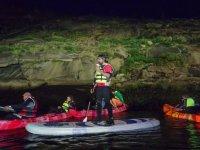 Ruta nocturna con kayaks y tablas de paddle surf