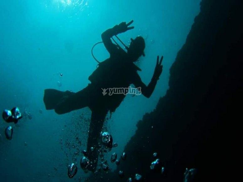 Divers waving at the camera