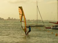 Learning windsurfing next to the boats