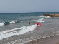 Entering the sea with the boards