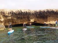Following the cliff paddle surfing