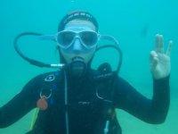 Diver waving at camera