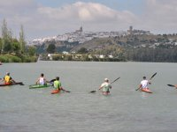 Kayaking in front of arches