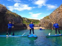 Paddle surfing in Llanes