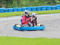 Adults and kids on the karting circuit