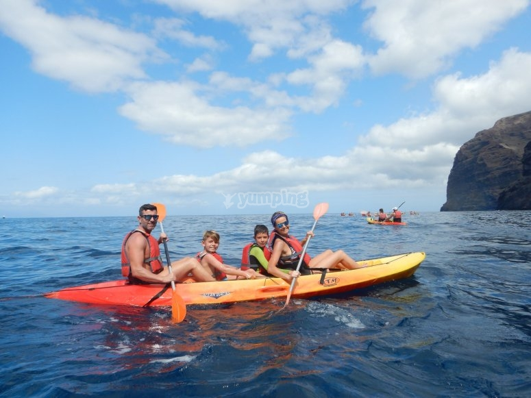 Family rowing on the kayak