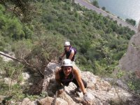 With the hands on the ferrata with gloves