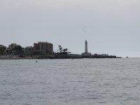 Playa de Maro y faro