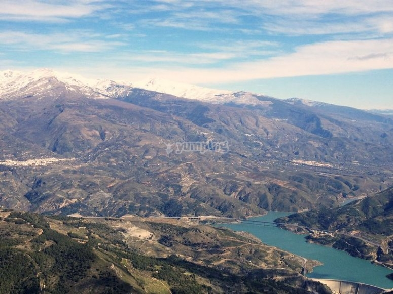 The Rules reservoir with the Alpujarra mountain range in the background