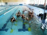 Diving baptism in indoor pool
