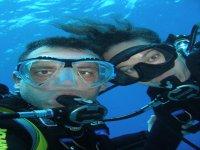 bautismo de buceo en mar