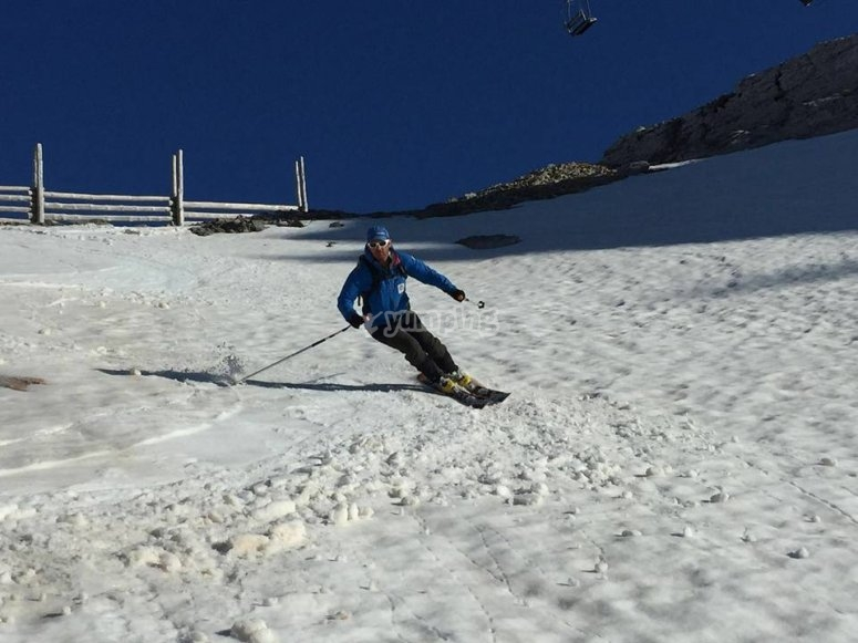 Professionals sliding across the snow